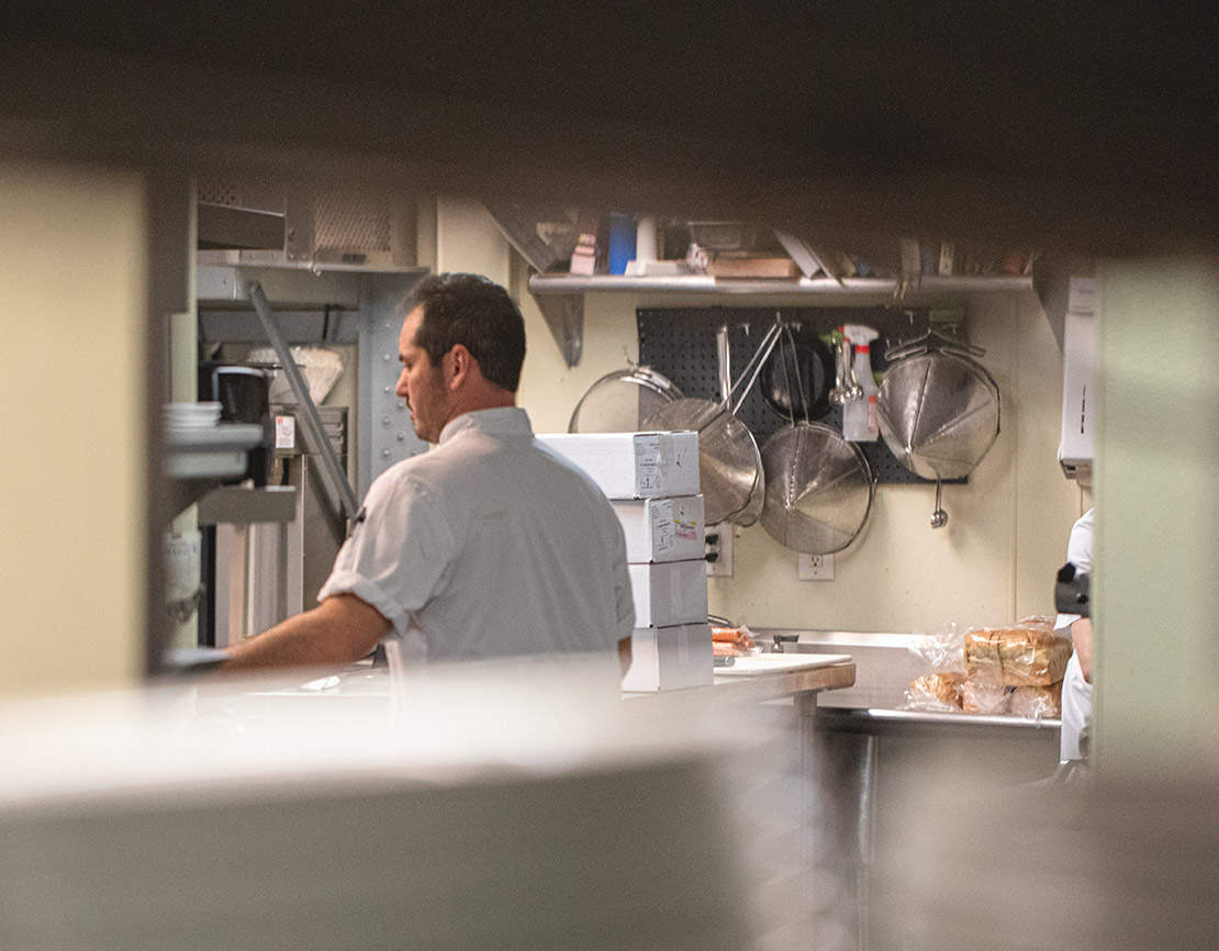 A chef in the kitchen of a restaurant.